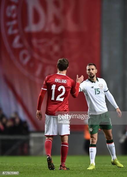 Copenhagen Denmark 11 November 2017 Conor Hourihane of Republic of Ireland with Andreas Bjelland of Denmark after the FIFA 2018 World Cup Qualifier...