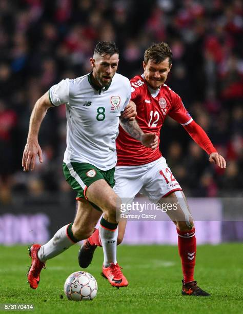 Copenhagen Denmark 11 November 2017 Daryl Murphy of Republic of Ireland in action against Andreas Bjelland of Denmark during the FIFA 2018 World Cup...