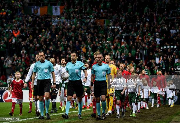 Copenhagen Denmark 11 November 2017 Referee Milorad Mai and his officials lead the sides out prior to the FIFA 2018 World Cup Qualifier Playoff 1st...