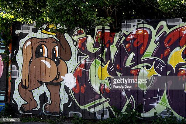 Copenhagen / Denmark _ Christiania area is famous for pusher street for selling illegal hash inside and outside graffiti on wooden wall and recording...