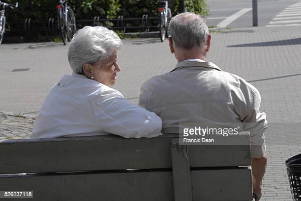 Copenhagen / Denmark _senior danes in other words retired couple enjoy sitting on bench 18 June 2012