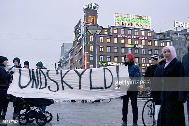 A group of youth display a banner reading 'Sorry' in support of those who critize the Danish daily JyllandPosten for publishing caricatures of the...