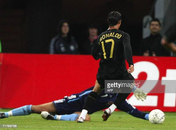 Penalty shot from Portugal's Cristiano Ronaldo is saved by Denmark goalkeeper Thomas Sorensen during the friendly match 01 September 2006 at Brondby...