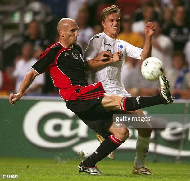 Ajax' Jaap Stam vies with FC Copenhagen's Jesper Groenkjaer during the UEFA Champions League third round first leg qualification soccer 09 August...