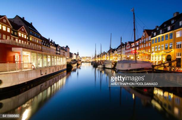 Copenhagen, Denmark at Nyhavn Canal port in Twilight time cityscape background