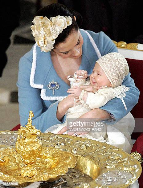 Danish Prince Christian Valdemar Henri John smiles in the hands of his mother Australian born Crown Princess Mary wife of Danish Crown Prince...