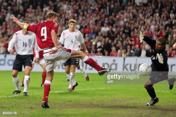 Denmarks Jon Dahl Tomasson scores against England during their international friendly soccer match at the Parken Stadium in Copenhagen17 August...