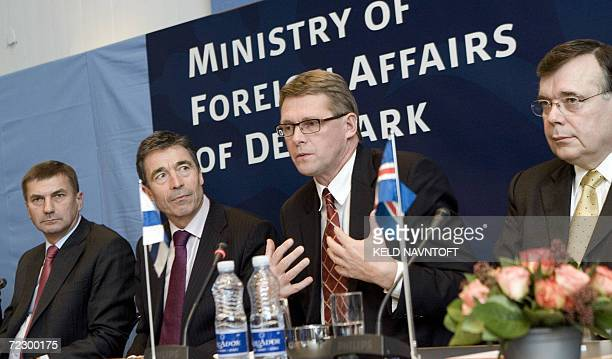 Finnish Prime Minister Matti Vanhanen with his counterparts Estonian Andrus Ansip Danish Anders Fogh Ramussen and Iceland Geir Haarde gestures at a...