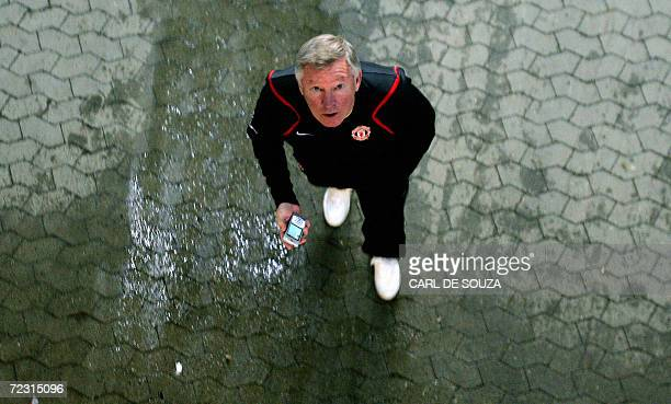 Manchester United's Manager Alex Ferguson attends a training session at Parken Stadium in Copenhagen 31 October 2006 on the eve of the UEFA Champions...