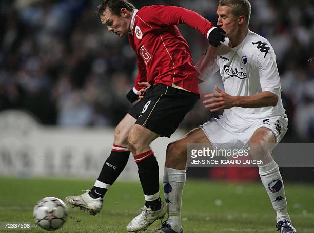 Manchester United's Wayne Rooney challenges FC Copenhagen's Norwegian player Brede Hangeland during their Champions League Group F soccer match in...