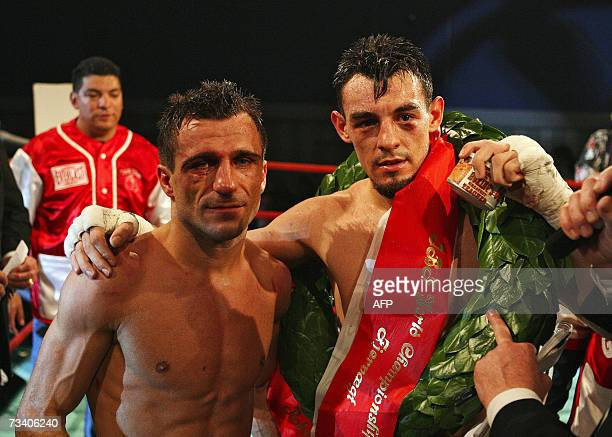 Robert Guerrero poses with his opponent Spend Abazi of Denmark 23 February 2007 after Guerrero won the vacant IBF cruiserweight world champion title,...