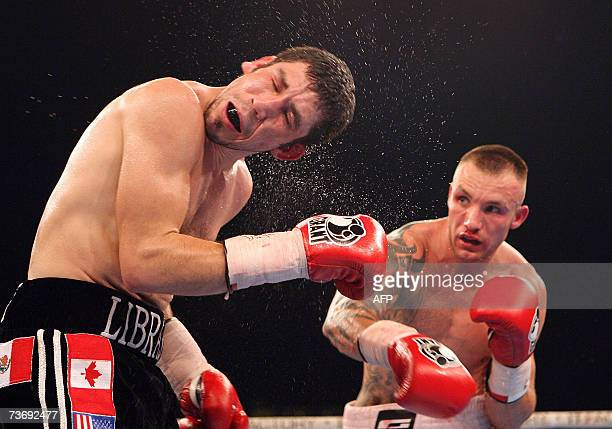 And WBC super-middleweigt boxing world champion Mikkel Kessler of Denmark hits his title contender Librado Andrade of Mexico during their fight 24...