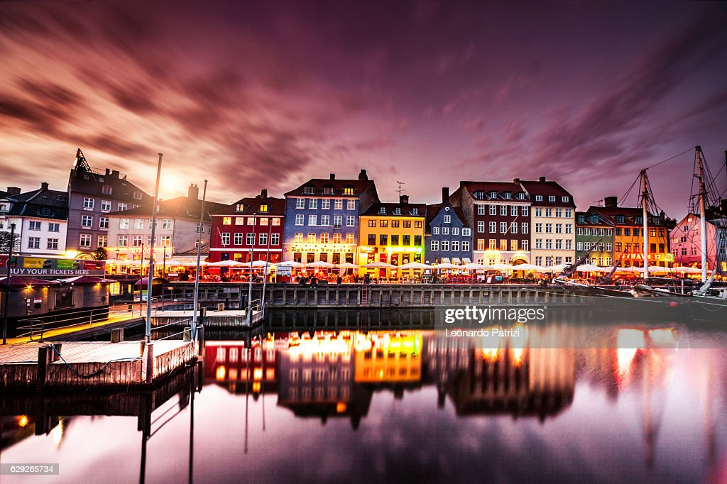 Copenhagen famous canal with boats and typical architecture : Stock Photo