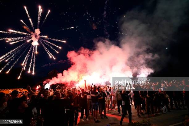 Copenhagen fans celebrate with flares after the UEFA Europa League round of 16 football match between FC Copenhagen and Istanbul Basaksehir on August...
