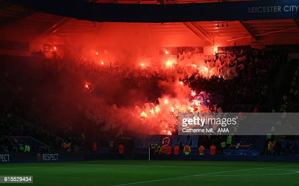 Copenhagen fans let off flares during the UEFA Champions League match between Leicester City FC and FC Copenhagen at The King Power Stadium on...