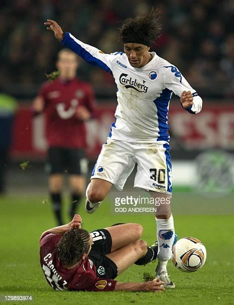 Copenhagen midfielder Christian Bolanos and Hanover's defender Christian Schulz vie for the ball during the UEFA Europa League Group B match Hanover...