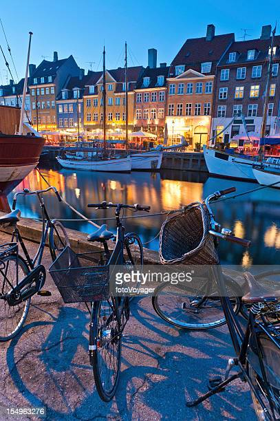 copenhagen nyhavn neon lights bicycles boats - nyhavn stock pictures, royalty-free photos & images