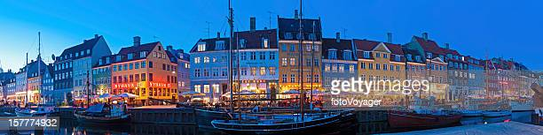 copenhagen nyhavn neon night illuminated waterfront denmark - nyhavn stock pictures, royalty-free photos & images