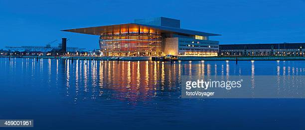 Copenhagen Opera House illuminated against blue dusk