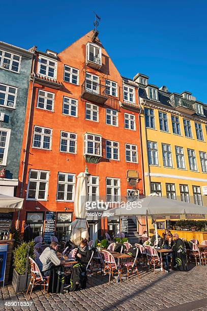 copenhagen people at outdoor cafe bars nyhavn denmark - nyhavn stock pictures, royalty-free photos & images