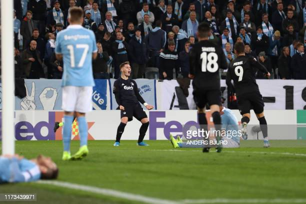 Copenhagen players celebrate after after Malmo FF's Danish defender Lasse Nielsen scored an own goal during the Europa League Group B football match...