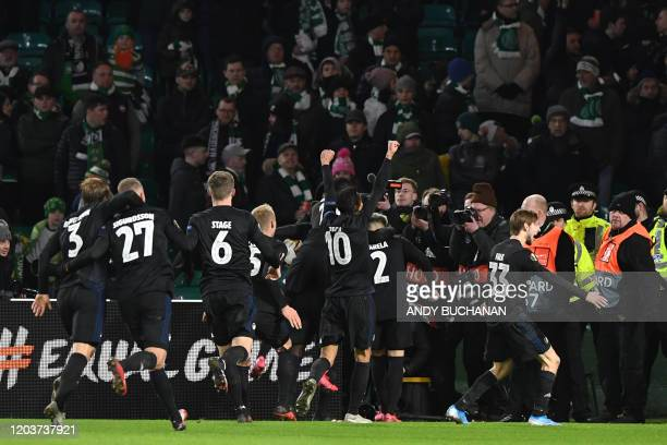 Copenhagen players celebrate their third goal during the UEFA Europa League round of 32 second leg football match between Celtic and Copenhagen at...