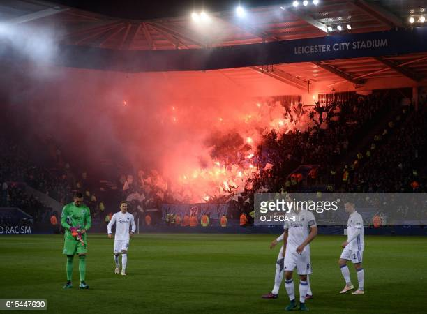 Copenhagen players react as their fans light flares in the stadium during the UEFA Champions League group G football match between Leicester City and...