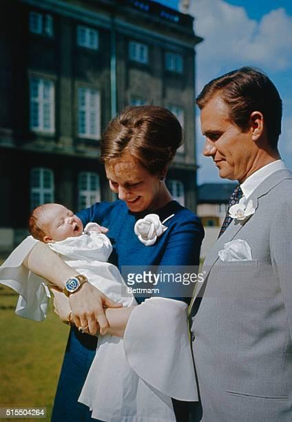 Princess Margrethe of Denmark holds her son named Frederik Andre Henrik Christian today in the garden of Amalienborg Palace in Copenhagen
