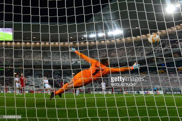 TOPSHOT Copenhagen Swedish goalkeeper Stephan Andersen jumps for the ball during the UEFA Europa league Group C football match between Bordeaux and...