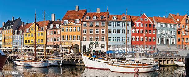 copenhagen vibrant harbour waterfront cafes bars panorama nyhavn denmark - nyhavn stock pictures, royalty-free photos & images