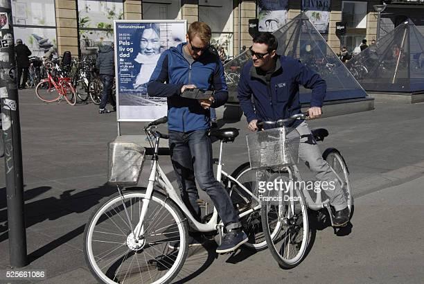 CopenhagenDenamrk _04 April 2015_Foreign tourists studing city map on city rental bikes