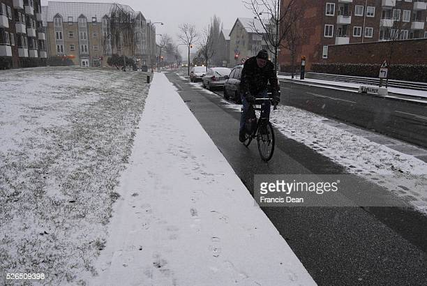 CopenhagenDenamrk_Male rides bicycle in snow weather in kastrup 02 February 2015