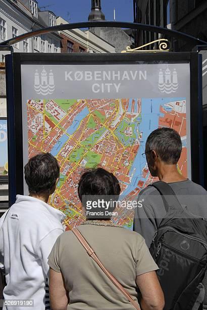 Copenhagen/Denmark/ 03 August 2015_Tourists Studing Copenhagen City May on Kobmagergade
