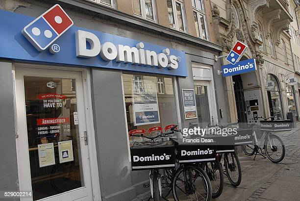 Copenhagen/Denmark/ _ 24 March 2016_American chain Dominos pizza delivery by Domino's bicycles