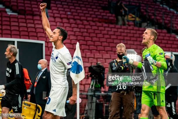 Copenhagen's Carlos Zeca and FC Copenhagen's goalkeeper Karl-Johan Johnsson cheer after the UEFA Europa League round of 16 football match between FC...