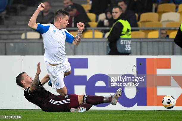 FC Copenhagen's Croatian defender Karlo Bartolec and Dynamo Kiev's Slovenian midfielder Benjamin Verbic in action during the UEFA Europa League Group...