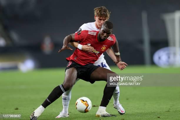 FC Copenhagen's Croatian midfielder Robert Mudrazija vies with Manchester United's French midfielder Paul Pogba during the UEFA Europa League...