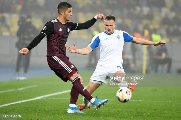 FC Copenhagen's Cypriot forward Pieros Sotiriou and Dynamo Kiev's Polish defender Tomasz Kdziora vie for the ball during the UEFA Europa League Group...
