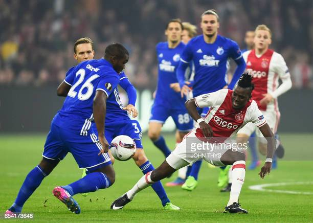FC Copenhagen's Danish defender Jores Okore vies with Ajax Amsterdam's forward Kasper Dolberg during the UEFA Europa League Round of 16 second leg...