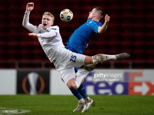 FC Copenhagen's Danish defender Victor Nelsson and Dynamo Kiev's Ukrainian forward Artem Besyedin vie for the ball during the UEFA Europa League...