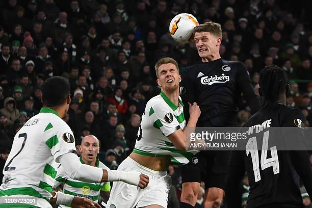 FC Copenhagen's Danish midfielder Jens Stage jumps for a header with Celtic's Norwegian defender Kristoffer Ajer during the UEFA Europa League round...