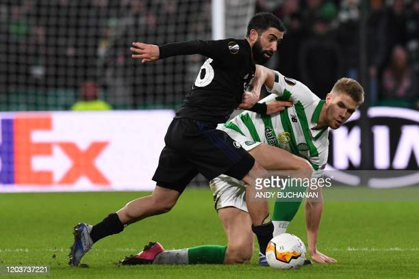 FC Copenhagen's Danish midfielder Nicolaj Thomsen vies with Celtic's Norwegian defender Kristoffer Ajer during the UEFA Europa League round of 32...