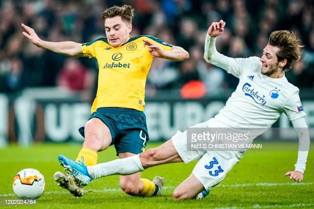 FC Copenhagen's Danish midfielder Rasmus Falk and Celtic's Scottish defender Jack Hendry vie for the ball during the Europa League last 32 first leg...