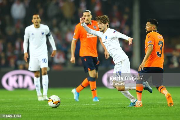 FC Copenhagen's Danish midfielder Rasmus Falk vies for the ball with Basaksehir's French defender Gael Clichy and French forward Enzo Crivelli during...