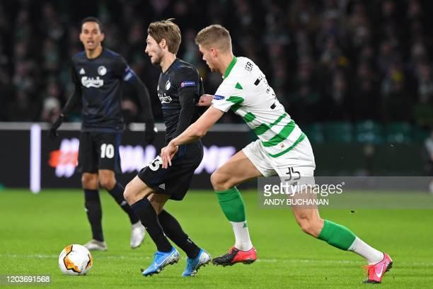 FC Copenhagen's Danish midfielder Rasmus Falk vies with Celtic's Norwegian defender Kristoffer Ajer during the UEFA Europa League round of 32 second...