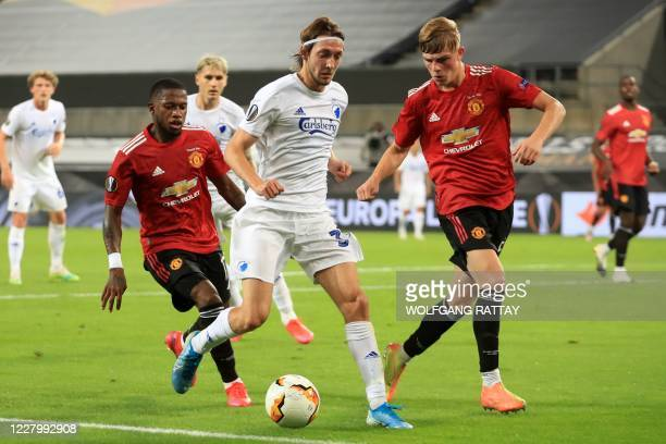 Copenhagen's Danish midfielder Rasmus Falk vies with Manchester United's Brazilian midfielder Fred and Manchester United's English defender Luke Shaw...
