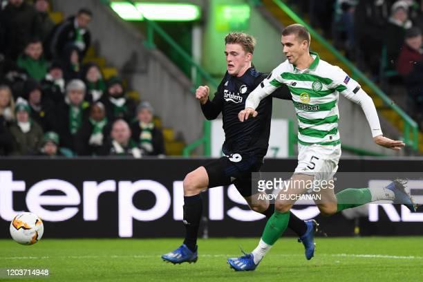 FC Copenhagen's Danish striker Mikkel Kaufmann vies with Celtic's Croatian defender Jozo Simunovic during the UEFA Europa League round of 32 second...