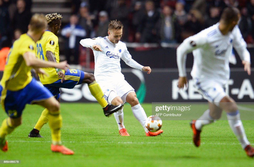 FC Copenhagen's defender from Sweden Pierre Bengtsson (C) and FC Fastav Zlin's midfielder from Nigeria Ubong Moses Ekpai(2nd L) vie for the ball during the UEFA Europa League group F football match FC Copenhagen v FC Fastav Zlin in Copenhagen, Denmark on November 2, 2017. / AFP PHOTO / Scanpix Denmark AND Scanpix / Mads Claus Rasmussen / Denmark OUT