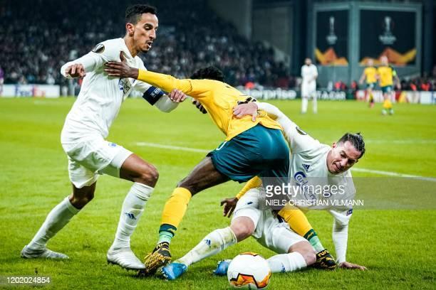 FC Copenhagen's Greek midfielder Zeca and FC Copenhagen's Costa Rican defender Bryan Oviedo vie for the ball with Celtic's Dutch defender Jeremie...