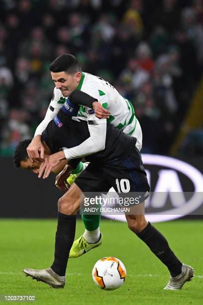 FC Copenhagen's Greek midfielder Zeca vies with Celtic's Australian midfielder Tom Rogic during the UEFA Europa League round of 32 second leg...
